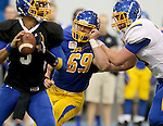 BROOKINGS, SD - APRIL 23:  Defensive end Christian Banasiak #69 from South Dakota State eyes quarterback Taryn Christion #3 while being pushed away by Evan Greeneway #78 during their Spring Game Saturday afternoon at the Sanford Jackrabbit Athletic Complex in Brookings.  (Photo by Dave Eggen/Inertia)