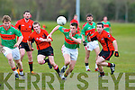 Brian Wall,Beale,hand passes the ball away from his persures Peter Shallow(Lt)& Mark Dennehy of Fossa at Fossa GAA grounds when the sides clashed last Saturday evening.