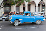 Havana, Cuba; a classic teal blue 1949 Pontiac modified pickup truck driving down the Paseo de Marti in Old Havana