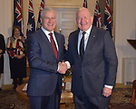 Australian Deputy Prime Minister Michael McCormack  (L) is sworn in by Governor General Peter Cosgrove (R)  at Government House, Canberra, Wednesday May 29, 2019. AFP PHOTO/ MARK GRAHAM