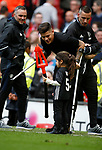 Marcos Rojo of Manchester United on crutches with his child during the English Premier League match at the Old Trafford Stadium, Manchester. Picture date: May 21st 2017. Pic credit should read: Simon Bellis/Sportimage