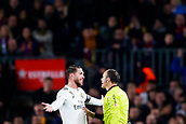 6th February 2019, Camp Nou, Barcelona, Spain; Copa del Rey football semi final, 1st leg, Barcelona versus Real Madrid; Sergio Ramos of Real Madrid argues a call with the referee Mateu Lahoz