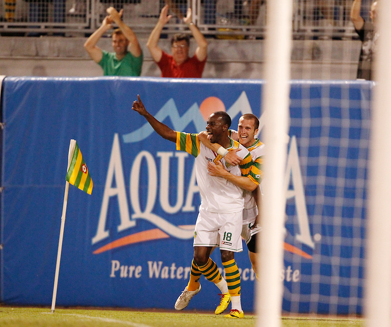 May 29, 2010; TAMPA, FLORIDA: Forward Aaron King #18 and Defender Rob Valentino #2 of the FC Tampa Bay Rowdies celebrate a goal by King during a match against the Puerto Rico Islanders at Steinbrenner Field in Tampa, Florida. FC Tampa Bay won 2-1. Photo by Matt May/FC Tampa Bay Rowdies