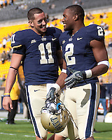 Pittsburgh quarteback Bill Stull (11) and tight end Dorin Dickerson (2). Pittsburgh Panthers defeat the University of Connecticut Huskies 24-21 on October 10, 2009 at Heinz Field, Pittsburgh, PA.
