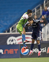 Seattle Sounders midfielder Servando Carrasco (23) and New England Revolution midfielder Benny Feilhaber (22) battle for head ball. In a Major League Soccer (MLS) match, the Seattle Sounders FC defeated the New England Revolution, 2-1, at Gillette Stadium on October 1, 2011.