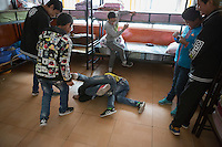 Blind and visually impaired Tibetan students play at the boys' dormitory of the School for the Blind in Tibet, in the capital city of Lhasa, September 2016.