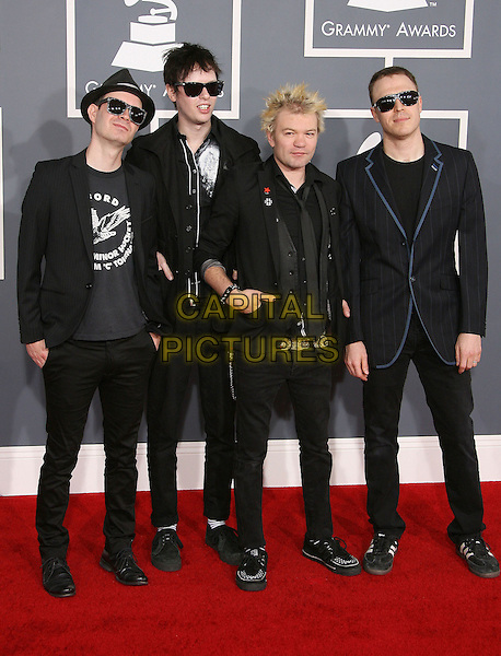 Tom Thacker, Steve Jocz, Jason McCaslin, and Deryck Whibley, Sum 41 .The 54th Annual GRAMMY Awards held at the Staples Center, Los Angeles, California, USA..February 12th, 2012.full length black jacket hat sunglasses shades band group.CAP/ADM.©AdMedia/Capital Pictures.