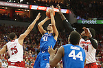 Guard Trey Lyles of the Kentucky Wildcats shoots during the game against  the Louisville Cardinals at KFC Yum! Center on Saturday, December 27, 2014 in Louisville `, Ky. Kentucky leads Louisville 22-18 at halftime. Photo by Michael Reaves | Staff