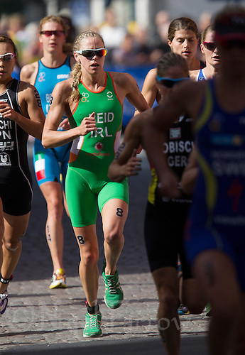 24 AUG 2013 - STOCKHOLM, SWE - Aileen Reid (IRL)  of Ireland runs through the streets of Gamla Stan the old part of Stockholm, Sweden during the elite women's ITU 2013 World Triathlon Series round (PHOTO COPYRIGHT © 2013 NIGEL FARROW, ALL RIGHTS RESERVED)