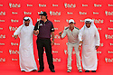 Rory McIlroy and Phil Mickelson taking part in a traditional Emirati Al Razfa dance ahead of the Abu Dhabi HSBC Golf Championship played at Abu Dhabi Golf Club 16-19 January 2014.(Picture Credit / Phil Inglis)