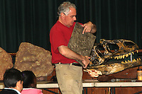 Neil Brown owner of Dinosaurs Rock shows a fossils and dinosaurs parts to St. Joseph School in Holbrook on Friday February 27, 2015.(Photo by Gary Wilcox)