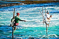 Stick fishermen on their awkward perches. (Photo by Matt Considine - Images of Asia Collection)