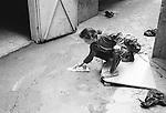 Shatila, UNRWA camp. A little girl is equalizing the fresh concrete in front of her house.<br />  <br /> Chatila, UNRWA camp. Une petite fille &eacute;galise la dalle de b&eacute;ton fra&icirc;chement coul&eacute;e devant sa maison..