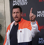 "Adam Sandler  arrives at the LA Premiere Of Netflix's ""Murder Mystery"" at Regency Village Theatre on June 10, 2019 in Westwood, California"