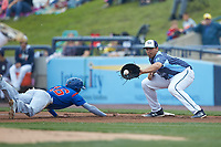 Reynaldo Rivera (14) of the West Michigan Whitecaps waits for a pick-off throw as Jared Young (16) of the South Bend Cubs dives back into first base at Fifth Third Ballpark on June 10, 2018 in Comstock Park, Michigan. The Cubs defeated the Whitecaps 5-4.  (Brian Westerholt/Four Seam Images)