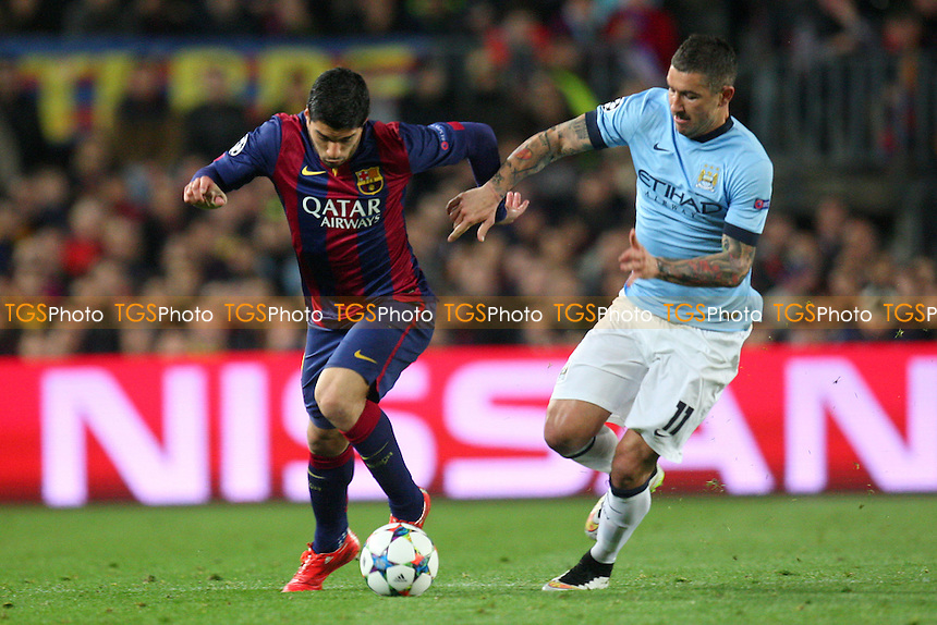 Aleksandar Kolarov of Manchester City and Luis Suarez of FC Barcelona - FC Barcelona vs Manchester City - European Champions League Round of Sixteen Football at the Camp Nou Stadium on  18/03/15 - MANDATORY CREDIT: Dave Simpson/TGSPHOTO - Self billing applies where appropriate - 0845 094 6026 - contact@tgsphoto.co.uk - NO UNPAID USE