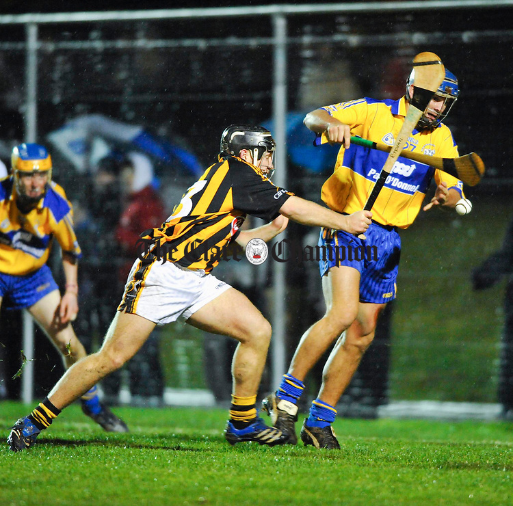 Richie Hogan of Kilkenny tackles Clare's  Gerry O Grady at the opening of the redeveloped O Garney Park in Sixmilebridge. Photograph by John Kelly.