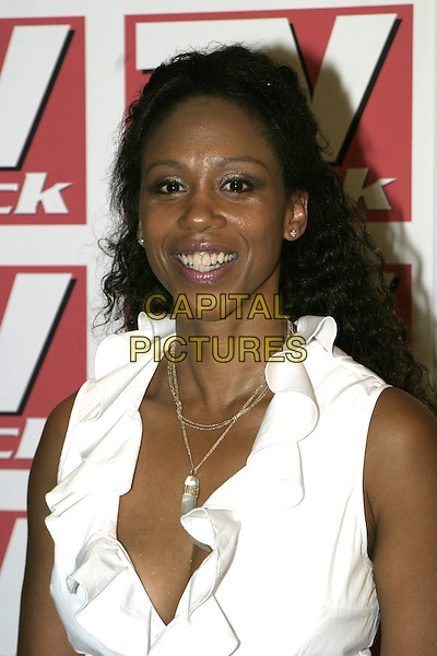 TRISHA GODDARD.TV Quick Awards 2004, The Dorchester Hotel, London, September 6th 2004..half length white ruffle shirt low cut plunging neckline gold necklaces.Ref: AH.www.capitalpictures.com.sales@capitalpictures.com.©Capital Pictures.