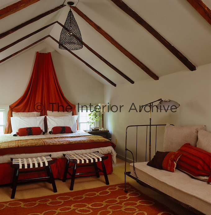 This attic bedroom has colourful and bright soft furnishings