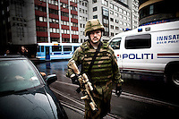Oslo, Norway, 25.07.2011. A member of the norwegian armed forces in downtown Oslo. On 22 July 2011, Anders Behring Breivik bombed the government buildings in Oslo, which resulted in eight deaths. He then carried out a mass shooting at a camp of the Workers' Youth League (AUF) of the Labour Party on the island of Utøya where he killed 69 people, mostly teenagers. Photo: Christopher Olssøn. ..----------------------------..-ITALY OUT-..----------------------------