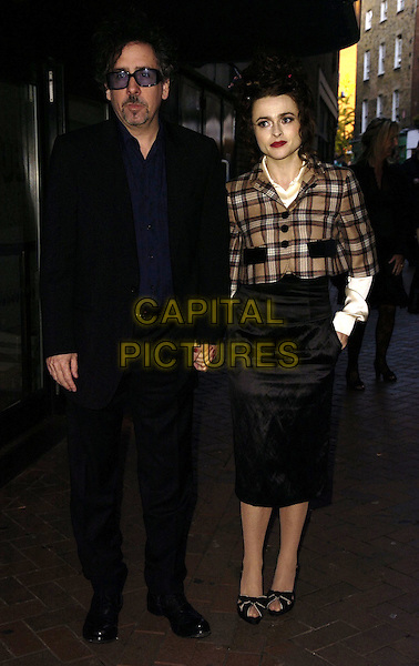 "TIM BURTON & HELENA BONHAM CARTER.At the Times BFI London Film Festival 3D Gala Screening of ""The Nightmare Before Christmas"", at Vue West End Cinema, London, England, October 29th 2006..full length couple brown plaid tartan jacket black pencil skirt high waisted purple sunglasses holding hands.Ref: CAN.www.capitalpictures.com.sales@capitalpictures.com.©Can Nguyen/Capital Pictures"
