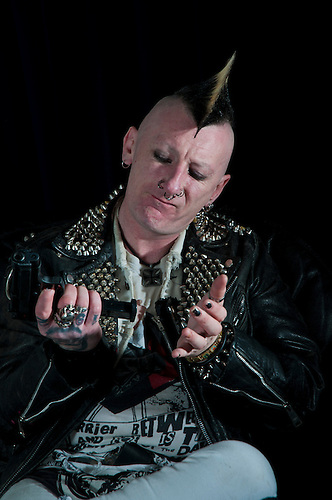 A punk rocker portrait. Shot in a studio.