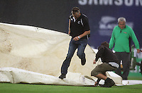 The covers get pulled over the wicket as play is stopped due to rain for the third time in India's batting innings during the 2nd ODI cricket match between the New Zealand Black Caps and India at Westpac Stadium, Wellington, New Zealand on Friday, 6 March 2009. Photo: Dave Lintott / lintottphoto.co.nz