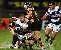 Jamie Helleur is tackled by Taranaki's Craig Clarke and Jayden Hayward. Air New Zealand Cup rugby match - Taranaki v Auckland at Yarrows Stadium, New Plymouth, New Zealand. Friday 9 October 2009. Photo: Dave Lintott / lintottphoto.co.nz