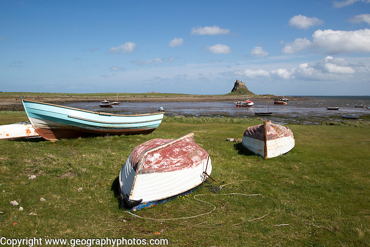 Castle and boats at low tide, Holy Island, Lindisfarne, Northumberland, England, UK