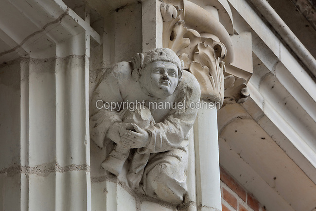 Cul-de-lampe corbel sculpture of a man, on the facade of the Louis XII wing, built early 16th century in Gothic style with Renaissance elements, at the Chateau Royal de Blois, built 13th - 17th century in Blois in the Loire Valley, Loir-et-Cher, Centre, France. The chateau has 564 rooms and 75 staircases and is listed as a historic monument and UNESCO World Heritage Site. Picture by Manuel Cohen