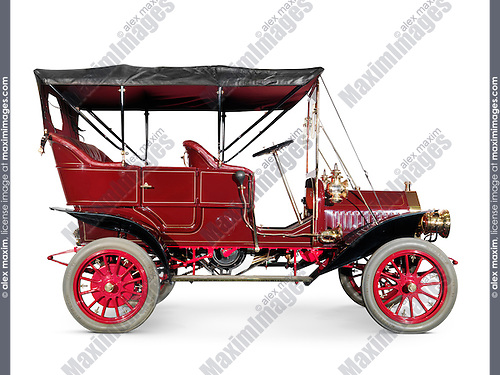 Red 1908 McLaughlin-Buick Model F antique vintage retro car side view isolated on white background with clipping path