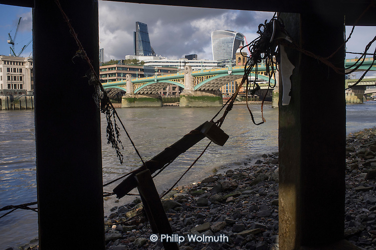 River Thames wharf and the Cheesegrater and Walkie-Talkie buildings in the City of London