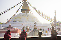 November 20, 2014 - Kathmandu (Nepal). Buddhist monks in front of the Boudhanath stupa in Kathmandu - also known as Bodnath, is the biggest stupa in Nepal and the holiest Tibetan temple outside Tibet. © Thomas Cristofoletti / Ruom