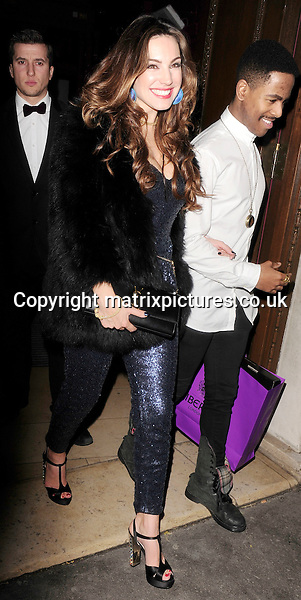 NON EXCLUSIVE PICTURE: MATRIXPICTURES.CO.UK<br /> PLEASE CREDIT ALL USES<br /> <br /> WORLD RIGHTS<br /> <br /> English model and television personality Kelly Brook is spotted as she leaves new venue Steam &amp; Rye following her 34th birthday celebrations in London, England.<br /> <br /> She was joined by a handful of famous friends and was beaming as she made her way home.<br /> <br /> The popular brunette is seen wearing a sparkly blue playsuit, black and gold heels with a black fur coat, and carrying a Liberty London shopping bag filled with birthday goodies.<br /> <br /> NOVEMBER 24th 2013<br /> <br /> REF: ASI 137567