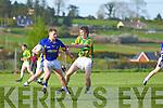 James Walsh of Knocknagoshal breaks away from Lispole's Donnacha Higgins last Saturday in Knocknagoshal..