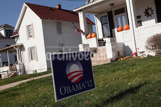 """US Presidential Election 2012: Pro-Obama front lawn election signs in a residential area near downtown Canton..Canton, OH, is the 73,000 resident county seat of Stark County in North-Eastern Ohio. Declared a """"bell weather"""" county by pundits and media, the electorate here seems to have an uncanny knack for picking the winner in recent presidential elections..November 6, 2012."""