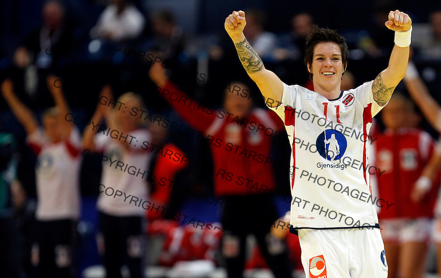 BELGRADE, SERBIA - DECEMBER 16: Anja Edin (R) of Norway celebrate the goal during the Women's European Handball Championship 2012 gold medal match between Norway and Montenegro at Arena Hall on December 16, 2012 in Belgrade, Serbia. (Photo by Srdjan Stevanovic/Getty Images)