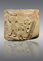 Upright picture of Alaca Hoyuk Sphinx Gate Hittite monumental relief sculpted orthostat stone panel. Andesite, Alaca, Corum, 1399 - 1301 B.C. Jugglers and acrobats.  Anatolian Civilizations Museum, Ankara, Turkey<br /> <br /> The juggler facing towards left, with long hair and a short dress, swallows a dagger; the smaller acrobats behind go up the stairs without holding on. All the figures have horned headdresses and earrings with a huge ring on their ears. It is thought that the acrobats are of different nationality, which is the reason why they are depicted smaller. <br /> <br /> Against a brown gray background.