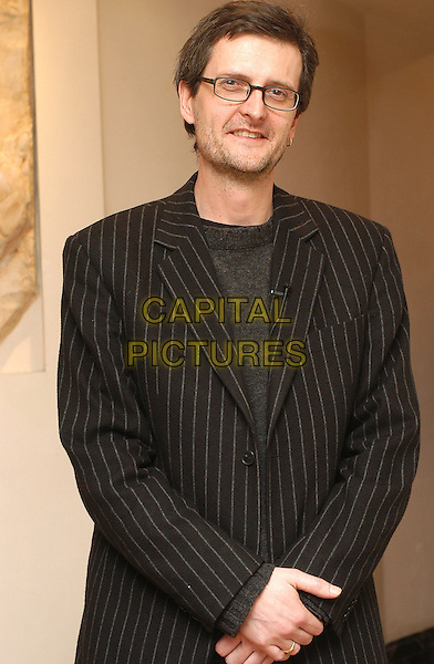 PER FLY.at photocall in Rome.23 March 2004.half length, half-length, pinstripe jacket, blazer.www.capitalpictures.com.sales@capitalpictures.com.© Capital Pictures.
