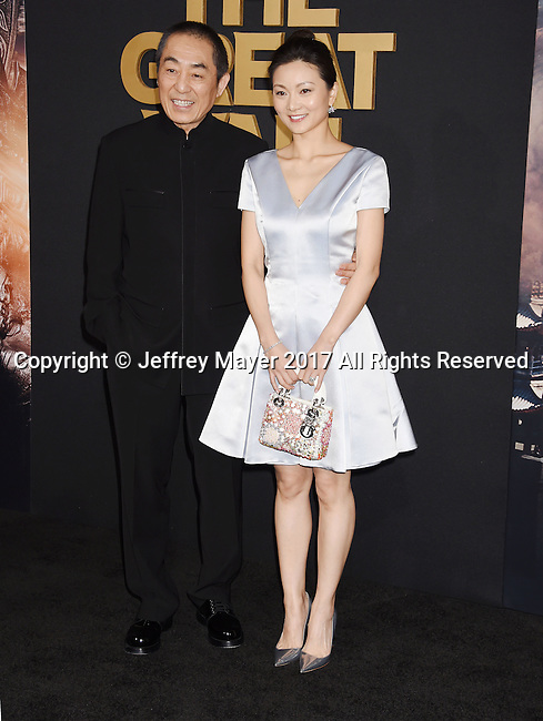 HOLLYWOOD, CA - FEBRUARY 15: Director Zhang Yimou (L) and Chen Ting arrive at the premiere of Universal Pictures' 'The Great Wall' at TCL Chinese Theatre IMAX on February 15, 2017 in Hollywood, California.