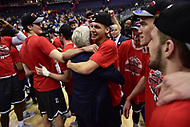 Washington, DC - MAR 11, 2018: Davidson Wildcats guard Kellan Grady (31) hugs head coach Bob McKillop  after winning the Atlantic 10 men's basketball championship between Davidson and Rhode Island at the Capital One Arena in Washington, DC. (Photo by Phil Peters/Media Images International)