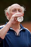 2013,August 21,Netherlands, Amstelveen,  TV de Kegel, Tennis, NVK 2013, National Veterans Tennis Championships,   drinking during changeover<br /> Photo: Henk Koster