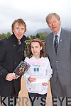 Rachel Kelleher, Ross Road Killarney who won the Art Competition was presented with her prize by Hector and Micheál O Muiracheartaigh on saturday