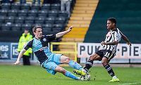 Stephen McGinn of Wycombe Wanderers slides in on Genaro Snijders of Notts County during the Sky Bet League 2 match between Notts County and Wycombe Wanderers at Meadow Lane, Nottingham, England on 28 March 2016. Photo by Andy Rowland.