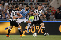 Calcio, finale Tim Cup: Juventus vs Lazio. Roma, stadio Olimpico, 20 maggio 2015.<br /> Lazio's Antonio Candreva, center, is challenged by Juventus' Andrea Barzagli, left, and Stephan Lichsteiner during the Italian Cup final football match between Juventus and Lazio at Rome's Olympic stadium, 20 May 2015.<br /> UPDATE IMAGES PRESS/Isabella Bonotto