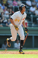 Outfielder Willy Garcia (24) of the West Virginia Power, a Pittsburgh Pirates affiliate, in a game against the Greenville Drive on May 20, 2012, at Fluor Field at the West End in Greenville, South Carolina. Greenville won 6-5. (Tom Priddy/Four Seam Images)