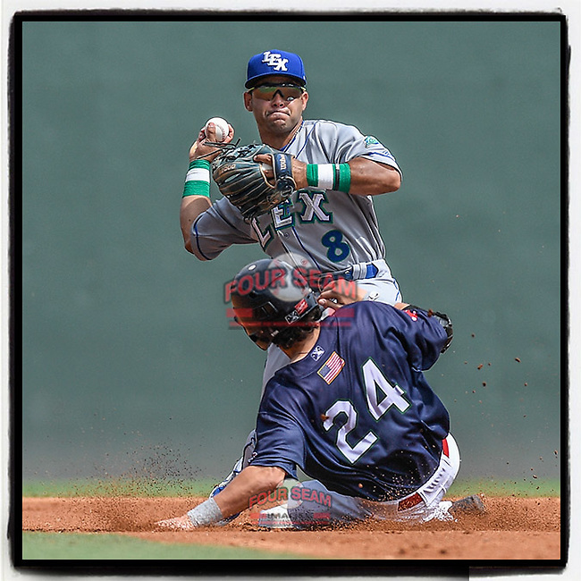Second baseman Ricky Aracena (8) of the Lexington Legends turns the first part of a double play attempt on Ryan Fitgzerald (24) of the Greenville Drive on Tuesday, July 17, 2018, at Fluor Field at the West End in Greenville, South Carolina. Lexington won, 10-3. (Tom Priddy/Four Seam Images)