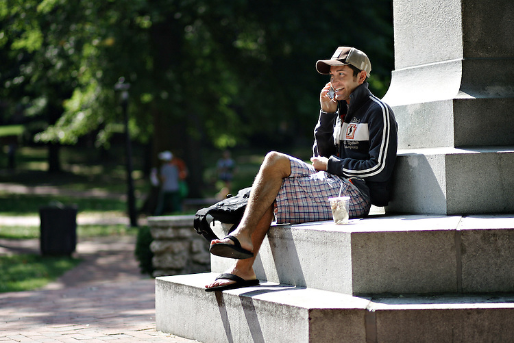 Political Science Junior Jimmy Dyer chats on the phone at the Campus Green between classes on Monday September 12, 2005.