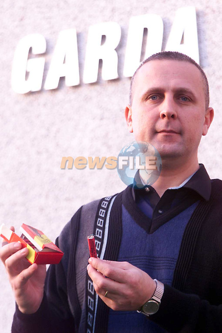 Crime prevention officer Kieran O'Halrhan with some of the Bangers on sale .Pic Fran Caffrey Newsfile