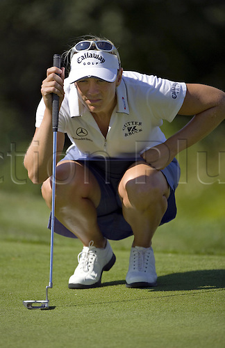 22 July 2005: Swedish golfer Annika Sorenstam (SWE) lining up a putt on the 17th green during the Evian Masters tournament held at the Evian Masters Golf Club, Evian, France. Photo: Nick Walker/Actionplus..050722 female woman ladies womens
